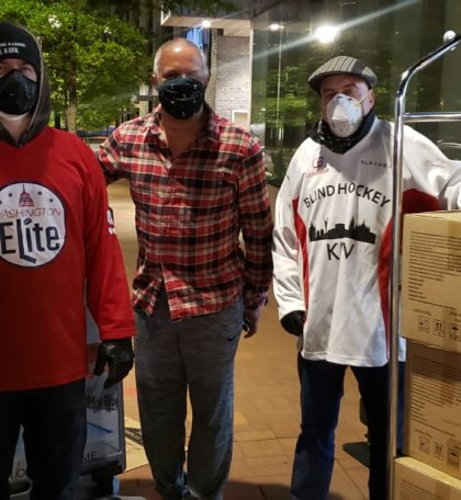 The American Red Cross accepted the donation of masks for Walter Reed Naval Military Medical Center. In this photo we see Veteran and Military Adaptive Sports Program (MASP) Site Coordinator, Patrick Johnson helping unload